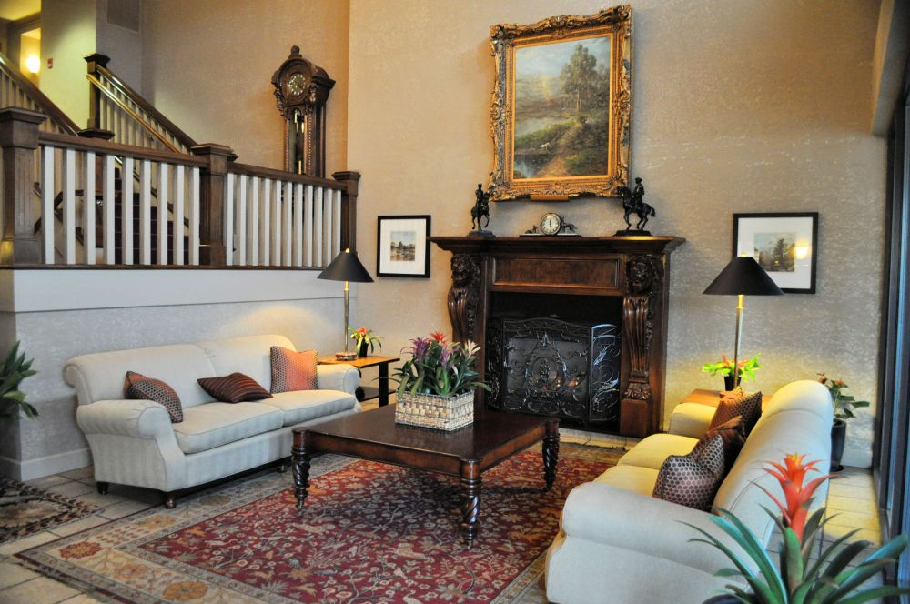 Hotel Bellwether's sitting room with a fireplace.